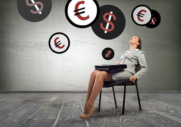 woman-business-money-currency-shutterstock.jpg